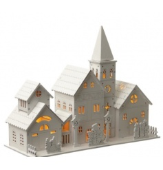 Make a beautiful festive display this season with this white wooden LED church ornament.