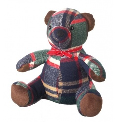 A charming check teddy bear doorstop with a cute red ribbon.