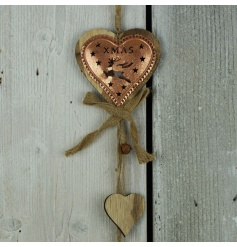 A rustic style copper garland in a heart design with reindeer cut out, rustic bells and a hessian bow.