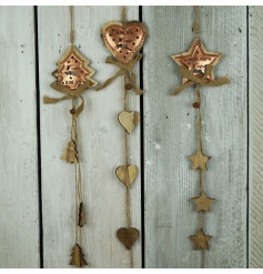 A rustic style copper garland in tree, heart and star designs with reindeer cut out, rustic bells and a hessian bow.