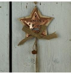A rustic style wooden star garland with a copper plate. Complete with a rustic bell and a hessian bow
