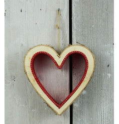 A chunky wooden heart decoration made from birch and red felt.