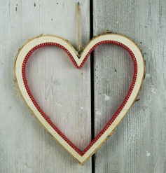 An elegant birch heart with red felt. A stylish decorative accessory for the home this season.