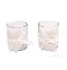 A mix of 2 candle pots with a white lace trim and clay heart and rose decoration to finish.