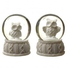 A mix of 2 charming owl snowglobes sat upon a knitted style base.