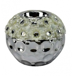 A glamorous and pretty t-light holder with a textured surface pattern and flowers.