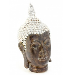 with its detailed patterns this Thai Buddha head is an absolute necessity for any calming environment.