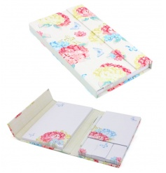 A pretty hydrangea organiser with notepad, post it notes and pen.