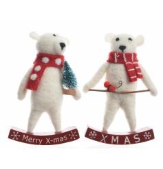 A mix of 2 adorable felt polar bear decorations sat upon a wooden rocking XMAS sign.