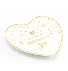 A heart shaped trinket dish with a heart gem and 'All I want for Christmas...is you' slogan.