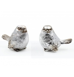 A set of 2 silver and champagne gold bird ornaments. Each has a vintage finish.