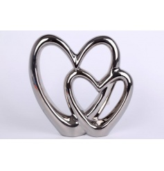 A stylish double heart ornament in silver. A chic decorative accessory for the home.
